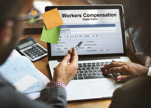 Workers' Compensation claim form on laptop screen